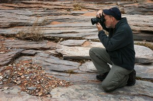 Photographing the striated bed of Big Spring Canyon near the Confluence Overlook trail head at Canyonlands.