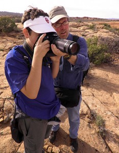 Robert gives photography pointers to his nephew David on the Delicate Arch trail.