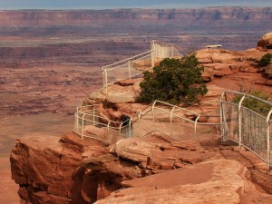 Robert moves along the winding fence at the Needles Overlook, Canyon Rims Recreation Area, Utah.