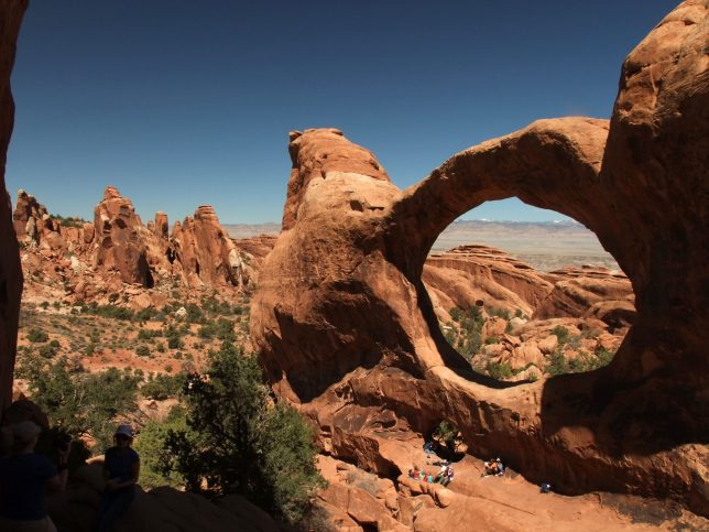 There is a fin just west-southwest of Double-O Arch on the Primitive Loop. To make this image, my back was against that fin to make this view showing the arches and the Devil's Garden beyond.