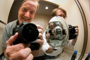 We stopped for the night in Santa Fe, New Mexico, where neither of us felt like we had made enough photos, so we got out our fisheye lenses and Robert's reflective hubcap and played around in our motel mirror.
