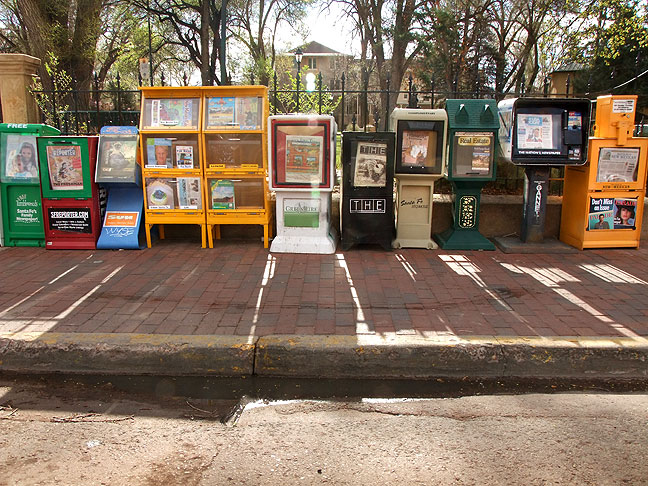 Somehow the high desert light has a way of making everything more beautiful, including these newspaper and magazine racks near The Plaza in Santa Fe.