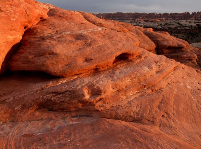 The sandstone at Squaw Flat picked up some truly unusual color and tone in the dusty sunset.