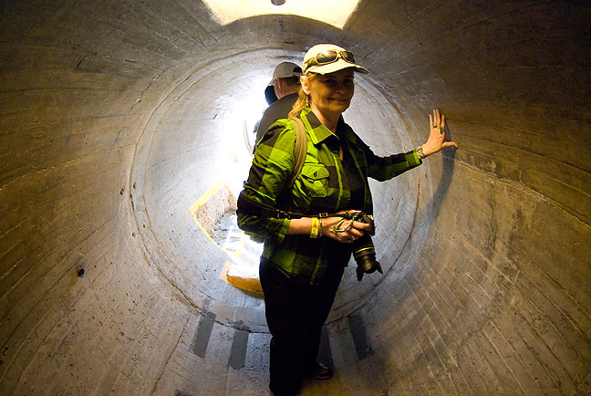 Abby smiles as she visits one of the access tunnels inside Hoover Dam. This tunnel leads from the main corridor to the exterior of the dam, where you can look out and see the river below.