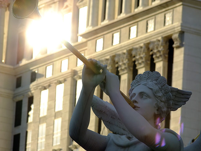 A trumpeter statue at Caesars Palace on the Las Vegas Strip gleams in late afternoon sunshine.