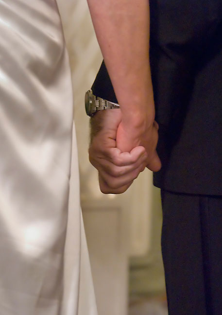 Nicole and Tracey hold hands as they exchange vows.