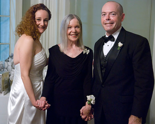 Tracey's mother Gayle poses with the happy couple.