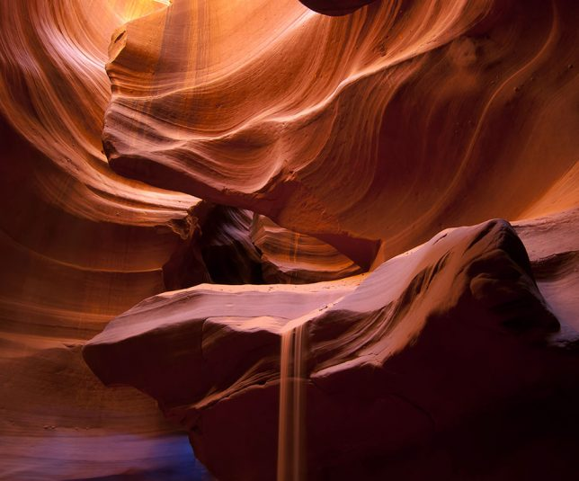 Despite its exquisite natural beauty, there are few venues as crassly commercialized in recent years as Antelope Canyon. I might have had a better experience in winter when there were far fewer people. The sand falling from the ledge was thrown there by our guide.