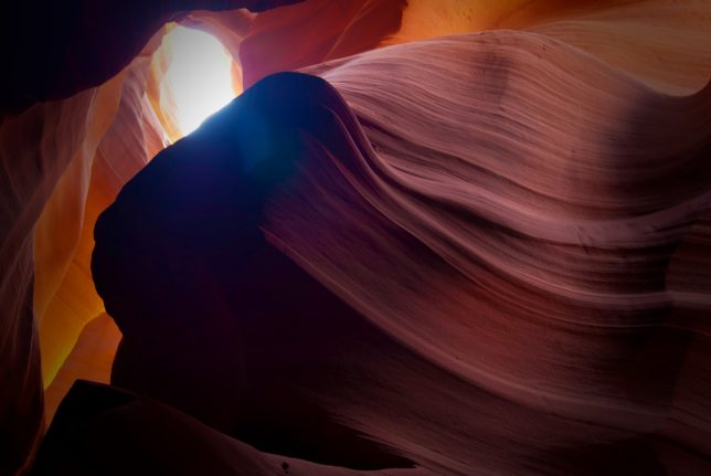 Looking almost straight up in the midst of Antelope Canyon, you can see patches of sky.