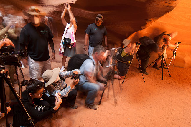 Crowds of photographers and tourists fill Antelope Canyon, making the experience stressful and commercialized.