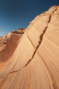 "The ""Great Wall"" near Waterholes Canyon is a wave-like swirl of mixed sandstone."