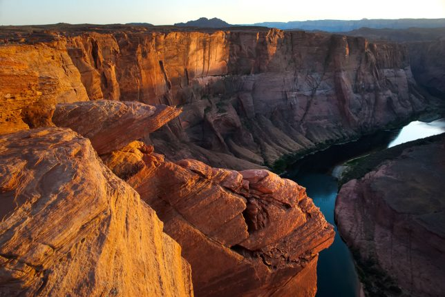 The golden moment arrives at Horseshoe Bend of the Colorado.