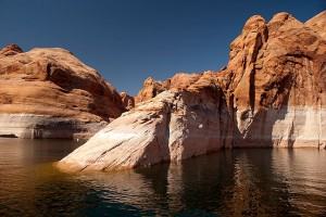 """The narrow Forbidden Canyon of Lake Powell clearly shows the """"bathtub ring,"""" the white portion above the water which would be submerged if the lake was at full pool. Park personnel told me that hasn't happened since 1983."""