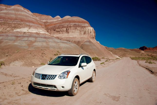 My Nissan Rogue sits by the side of the road near Old Paria.
