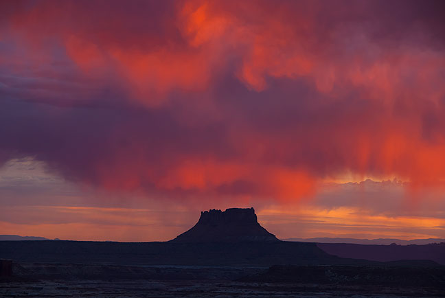 Virga is illuminated by early morning light over Ekker Butte in The Maze District at Canyonlands.