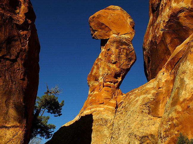 This oddly-angled hoodoo on the Devil's Garden trail is set against a perfect pearl-blue sky.