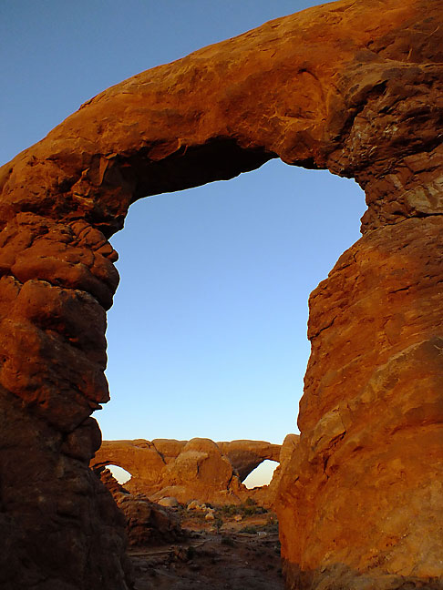 Last light filtered through etherial clouds at sunset gave Turret Arch, through which are visible the South and North Windows, just the right glow.
