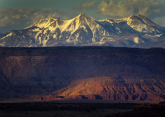 Last light graces Canyonlands National Park, Utah, with the snow-capped La Sal Mountains beyond.