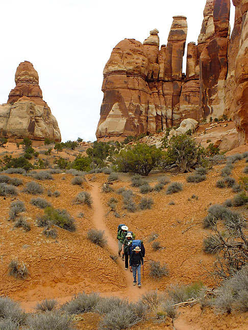 Backpackers make their way to backcountry campsites in the Needles.