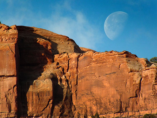 The moon sets over Bridger Jack Mesa viewed from Indian Creek on route to Canyonlands National Park.