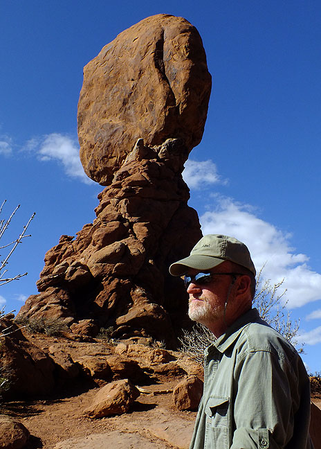 The author cogitates the majesty of the American west at Balanced Rock in Arches National Park.