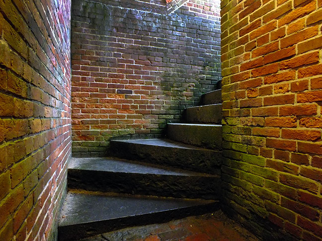 Stairs create a nice spiral line toward daylight in this Fort McHenry storage area; due to proximity to the bay, everything underground remains damp and moldy.