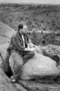 David Martin rests during a hike near Bat Cave Mountain, 1995.