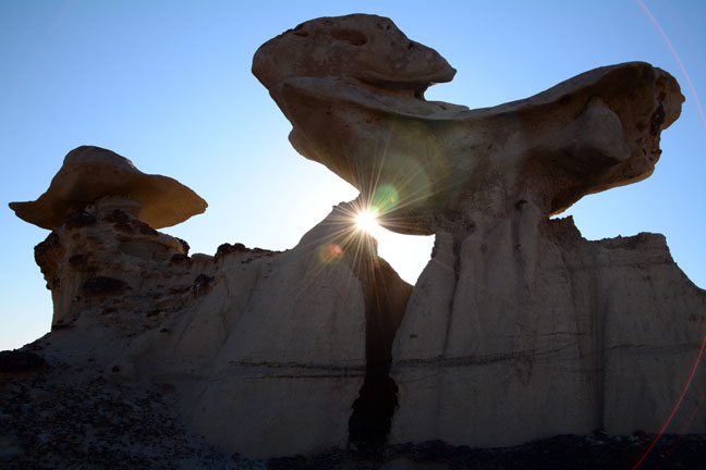 Morning sunshine streams through hoodoos at northwestern New Mexico's Bisti Wilderness.