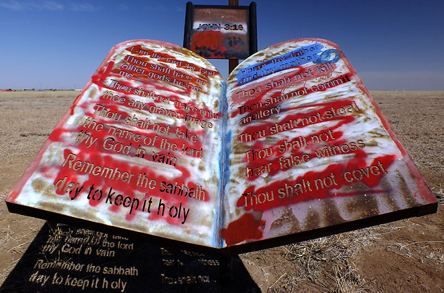 "The Bible's Ten Commandments were etched in steel, then graffiti tagged, at the Texas panhandle ""peace park."""