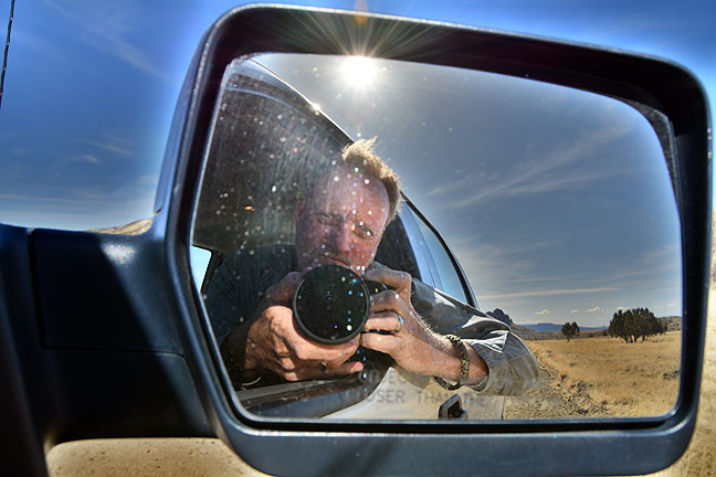 As we drove the lonely road toward Cabezon Peak, I made this pensive self portrait in Greg's mirror.