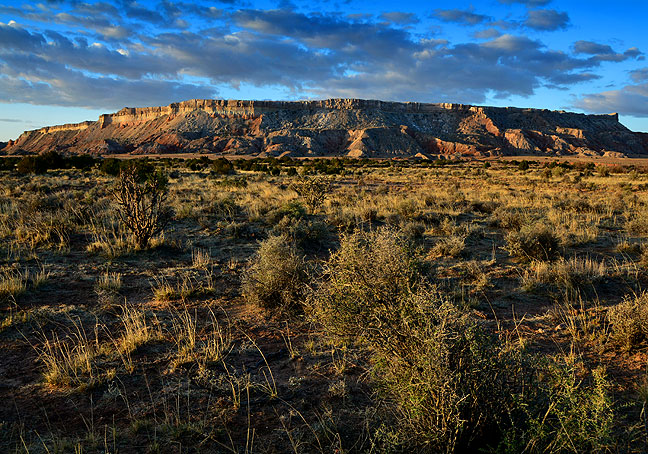 Morning light shines on the long, elegant Mesa Prieta near San Ysidro, New Mexico.