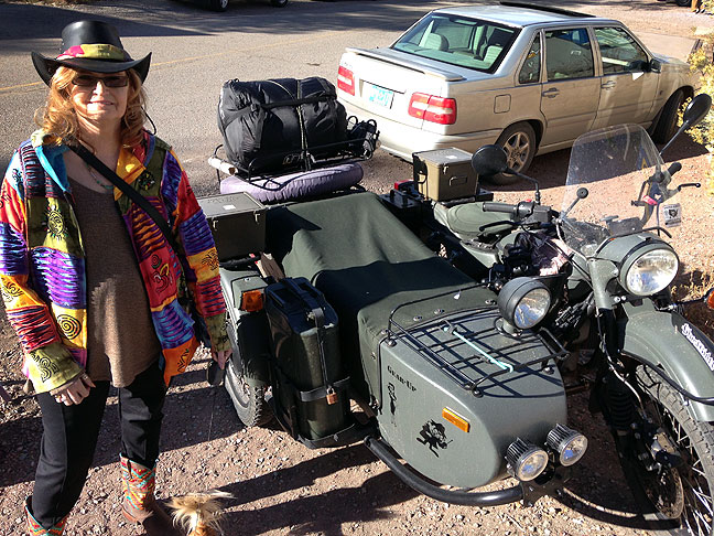 Abby poses by a Russian military motorcycle with a sidecar in Madrid, New Mexico. She talked with the owner for a while, who said he takes it to hunt, travel on four-wheel-drive roads, and even took it to the bottom of the Grand Canyon.