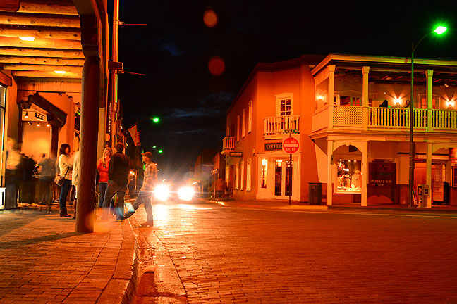 It is comforting, somehow, to see that people still get out at night, as in this Santa Fe Plaza image.