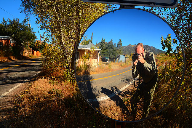 With Robert in mind (who is constantly photographing mirrors), I made this self-portrait in a blind corner mirror on the highway in Arroyo Seco, New Mexico.