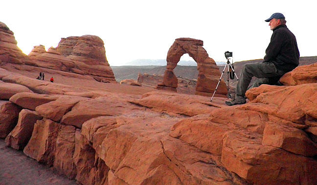 A friendly fellow hiker made this image of me photographing Delicate Arch before sunrise.