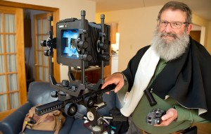 Greg Smith shows off his new used large format camera at his Albuquerque home.