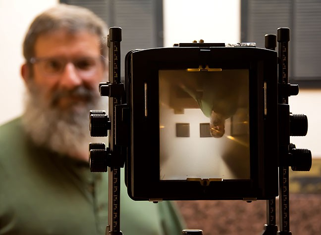 "Greg Smith poses with his large format camera; the inverted image on the ground glass is one of the ""old school"" joys of the view camera."