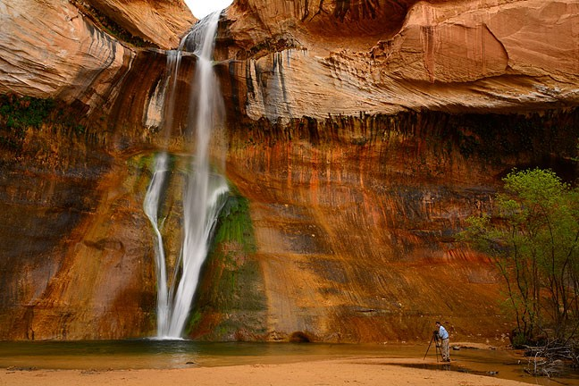 Using a fellow photographer for scale helps illustrate the size and beauty of Lower Calf Creek Falls.