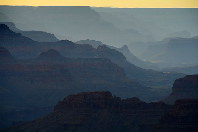 Many layers of erosion, both vertical and horizontal, create depth in this image at the Grand Canyon.