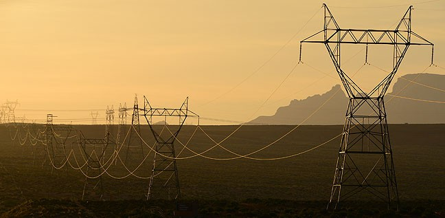 Power lines lead away from the Navajo Generating Station in northern Arizona.