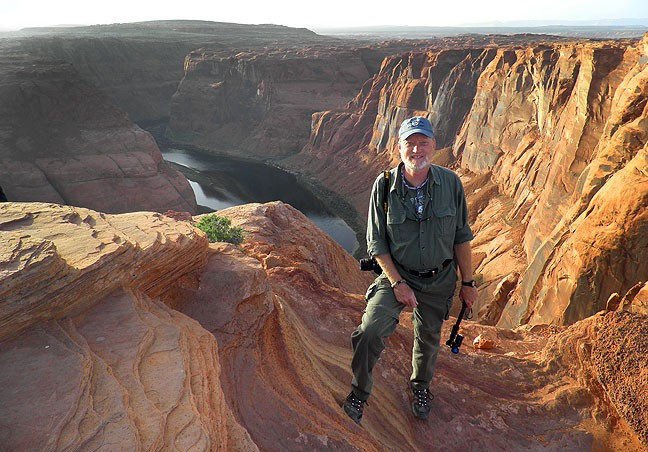 Your host smiles for a photo at Horseshoe Bend of the Colorado. There was no shortage of people who were happy to take my picture with my camera if I asked.