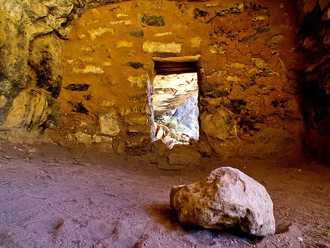 A stone sits on the floor at an ancestral Puebloan cliff dwelling at Walnut Canyon National Monument.