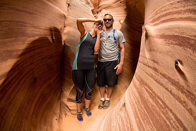 I ran into this nice couple from San Francisco, Martha and Gray, at Zebra Slot Canyon. Martha is using one of my cameras to photograph me photographing them.