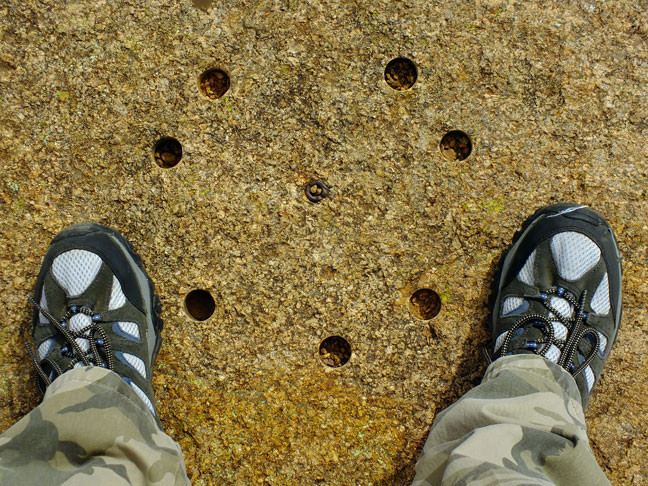 Near the trail head above Treasure Lake I spotted these drill holes in a boulder. I don't know their use.