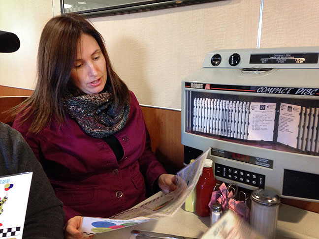 Chele looks over the menu at the Bel-Loc Diner.