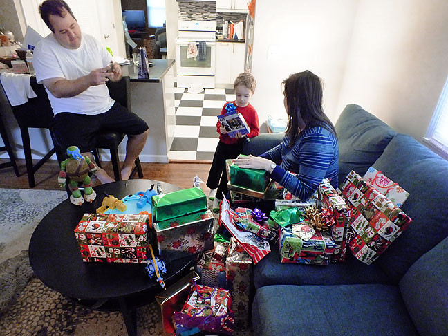 Tom, Paul and Chele prepare to open gifts on Christmas morning.