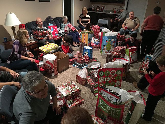 The whole family gathered in the downstairs den at Tom's mother's house to exchange gifts.