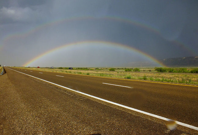 You can see raindrops on my lens in this image showing a full, bright double rainbow looking east along interstate 40 in eastern New Mexico.