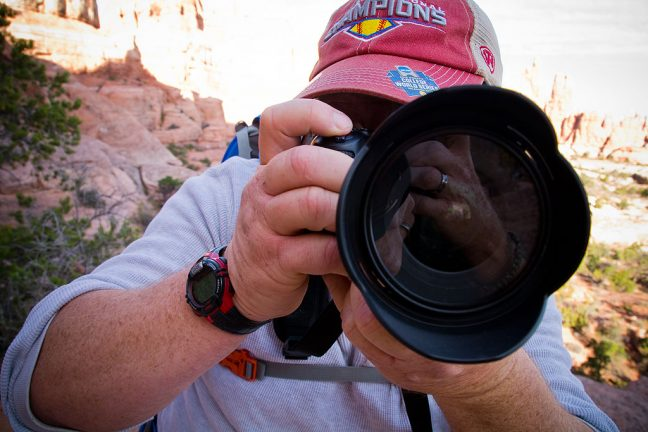 ...as I photographed him with his camera.