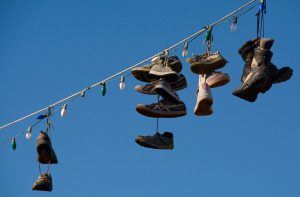 Shoes hang on an overhead power line in Madrid, New Mexico.
